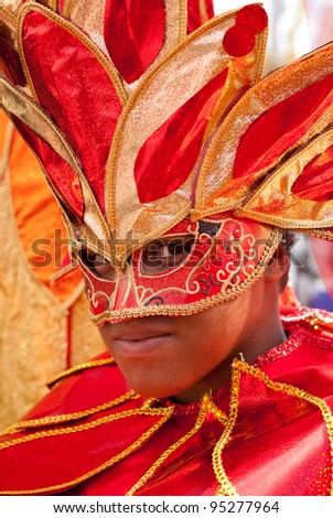 PORT OF SPAIN - FEBRUARY 11: Michael Barnes playing Mas at the Red Cross Children's Carnival celebrations on February 11, 2012 in Port Of Spain, Trinidad & Tobago.  Exotic costumes are usually on show. - stock photo