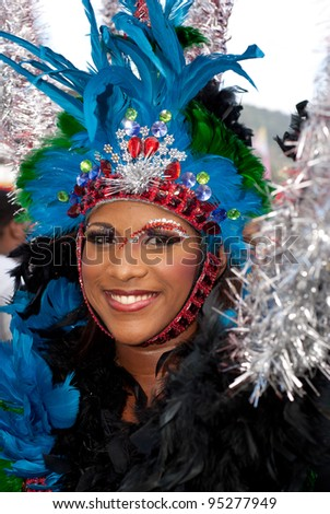 PORT OF SPAIN - FEBRUARY 11: Soriya Scotland playing Mas at the Red Cross Children's Carnival celebrations on February 11, 2012 in Port Of Spain, Trinidad & Tobago.  Exotic costumes are usually on show. - stock photo