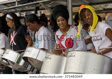 PORT OF SPAIN, TRINIDAD - February 9: Exodus steel orchestra band members perform in down town Port of Spain on carnival Tuesday, February 9, 2016 on the streets of Port of Spain, Trinidad.