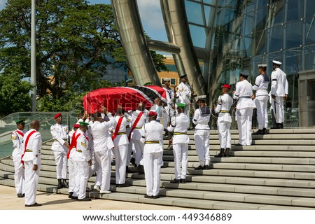 PORT OF SPAIN, TRINIDAD - July 8: Soldiers carry the casket bearing former prime minister Patrick Manning, July 8,2016 into the National Academy for the Performing Arts for public viewing.