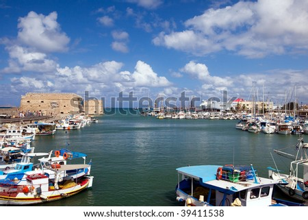 Port of the city of Iraklion and kind on the Venetian port with a fortress - stock photo