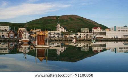 Port of the fishing village of Husavik, Iceland. - stock photo