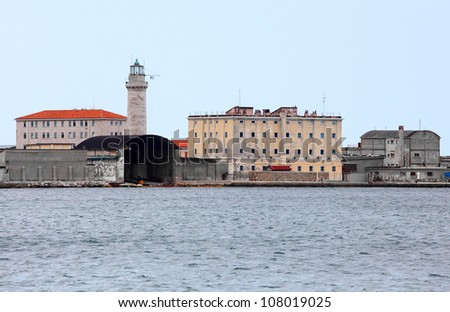 Port of Trieste with ancient lighthouse. Adriatic sea, Italy, Europe. - stock photo