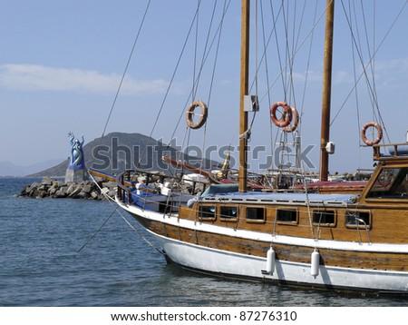Port of Turgutreis with sailing ship in Turkey - stock photo