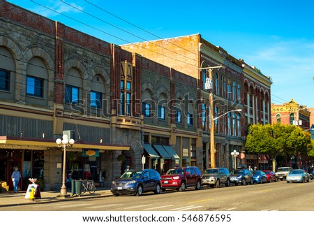 PORT TOWNSEND, WA - SEPTEMBER 15, 2016: Old buildings along Water Street in this historic town on Washington's Olympic Peninsula retain a vintage appeal for the many travelers who pass through.