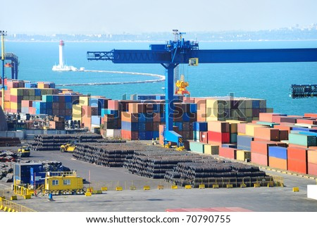 Port warehouse with containers and industrial cargoes - stock photo