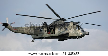 PORT WARNEMUENDE, GERMANY - AUGUST 09 Flight of military helicopter on 09 August, 2014 during the 24th annual Hanse-Sail event Rostock, Germany  - stock photo