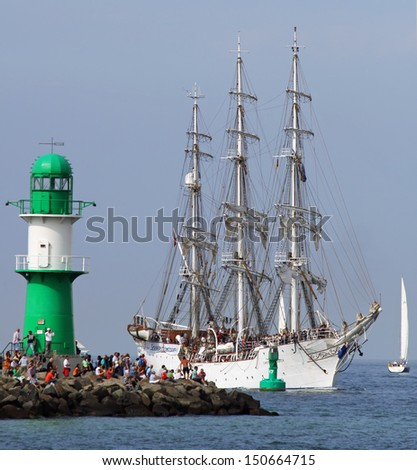 "PORT WARNEMUENDE, GERMANY - AUGUST 10. Old norwegian Sailing ship ""Christian Radich"" arrives at the port Rostock on August 10, 2013 for the 23. Hanse-Sail, Mecklenburg-Vorpommern, Germany - stock photo"