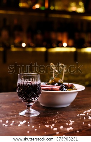 Port wine and olives - stock photo