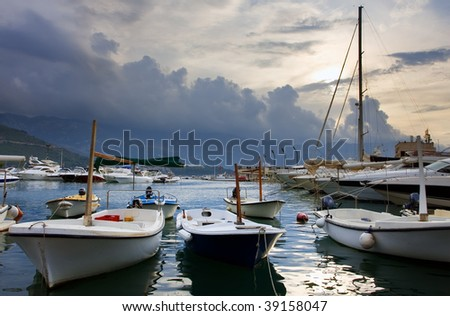 Port with boats and yachts at the morning sky - stock photo