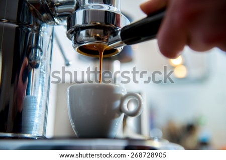 porta filter espressomachine in front of bright background - stock photo