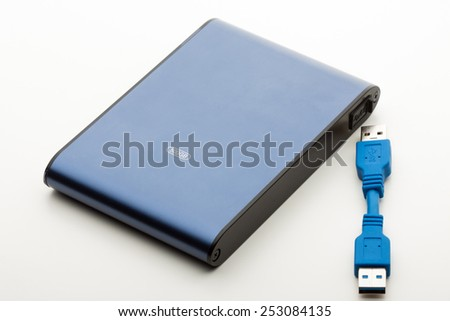 Portable and mobile external Hard Disk Drive (HDD) on white background - stock photo