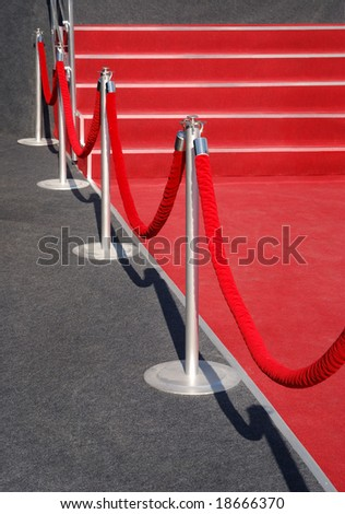 Portable Barrier for Queue Control. Red security rope by red carpet. event object - stock photo