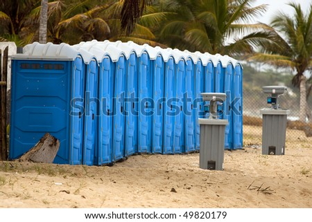 portable bathroom on the beach - stock photo