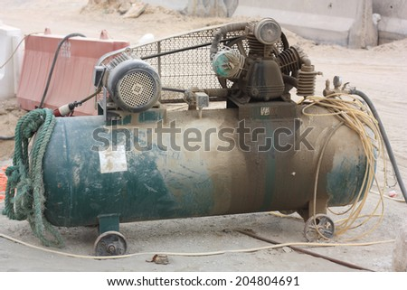 Portable compressor unit with pressure gauge and hoses - stock photo