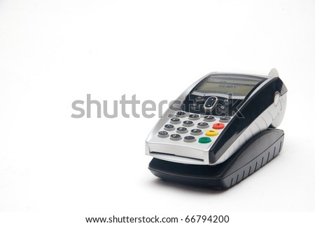 Portable Credit Card Terminal on Base - stock photo