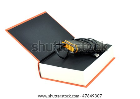Portable disk in a thick book - stock photo