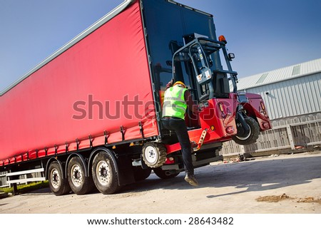 Portable Forklift Offloading Shipment - stock photo