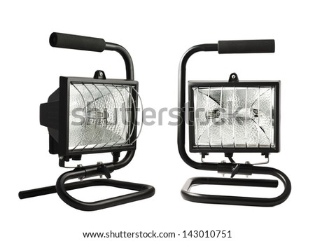 Portable halogen construction lamp with a handle isolated over white background, set of two foreshortenings - stock photo