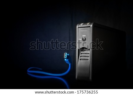 Portable HDD box with USB cable - stock photo