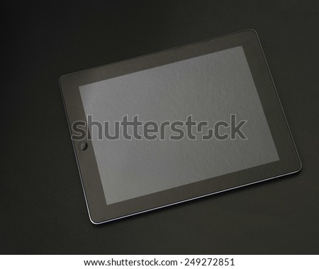 Portable mobile computer on a black surface/Mobile Computing/Black computing device on a black surface - stock photo