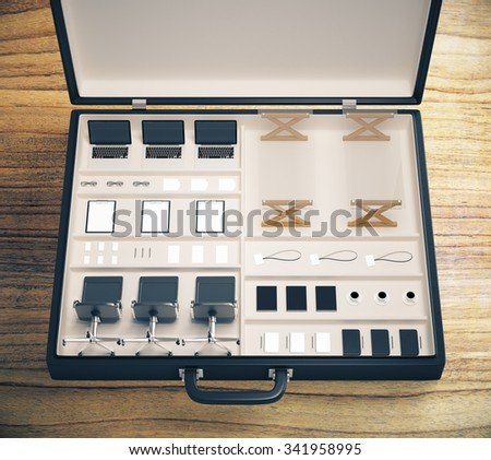 Portable office concept with office accessories and other stuff inside one case - stock photo