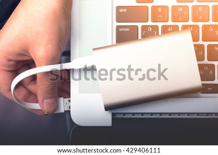 Portable power bank ready to charge power with laptop. - stock photo