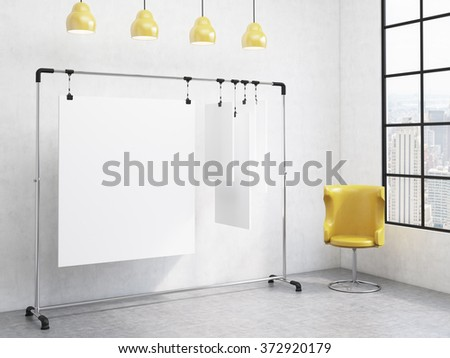 portable rack for paper in corner of room, paper sheets clipped to it, window with a city view to the right, yellow chair to the right, four yellow lamps above. Concept of demonstration. 3D rendering - stock photo