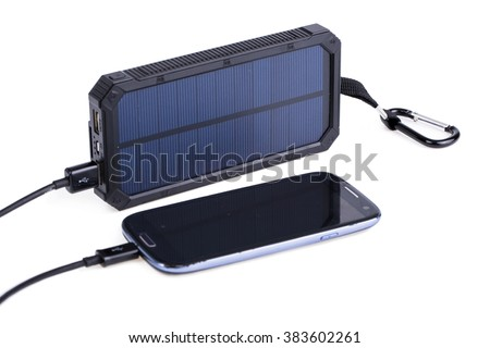 Portable solar panel for charging mobile devices isolated. - stock photo