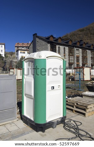 portable toilet at a construction site - stock photo