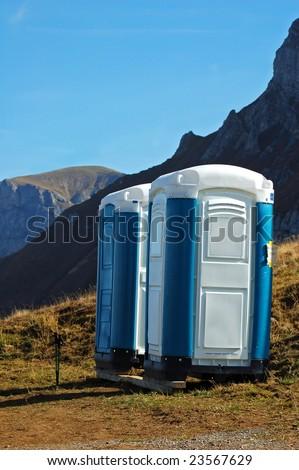 Portable toilet over 7000 feet on Axalp in Switzerland - stock photo