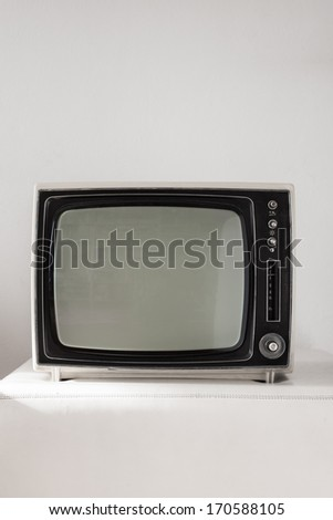 Portable vintage television on white background - stock photo