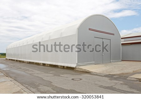 Portable Warehouse Building Structure for Temporary Storage - stock photo