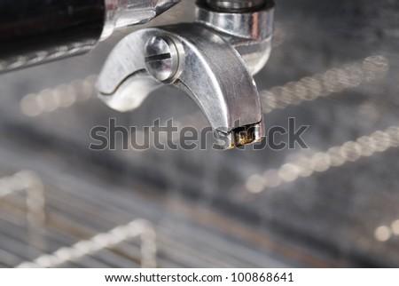 Portafilter and coffee machine. Focus on nearest spout. - stock photo
