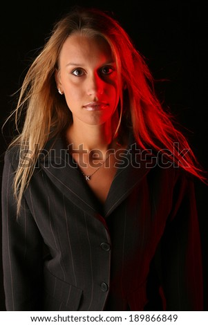 Portait of a beautiful girl made with ring light and some red backlight - stock photo