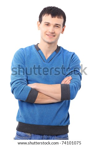 Portait of a handsome young man standing with his hands in pocket against white background