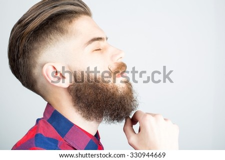 Portait of a hipster guy with beard and mustache.