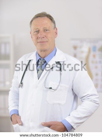 Portait of a mature male doctor at office - stock photo