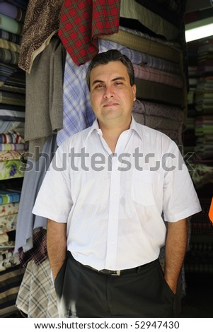 portait of  a proud and confident retail store owner - stock photo