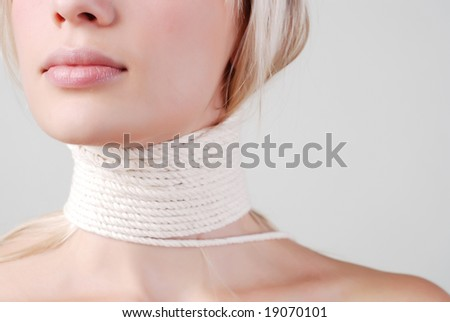 portait of beautiful woman with the white rope on the neck