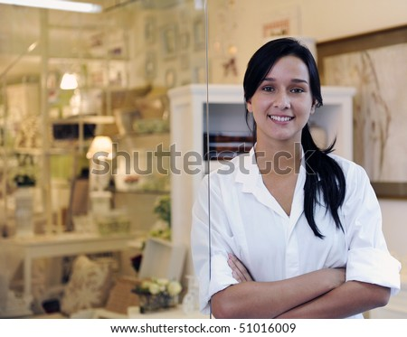 portait of small business owner: proud woman and her store - stock photo
