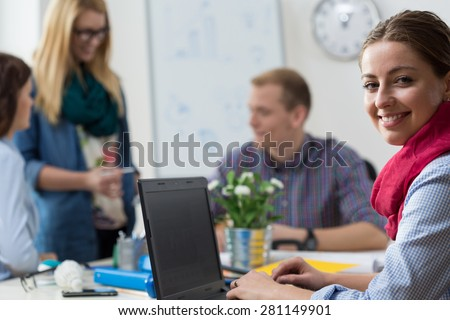 Portait of smiling young intern at office - stock photo