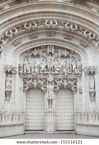 Portal on the facade of the Brou Monastery - stock photo