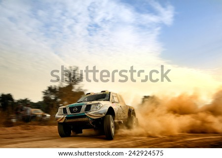 PORTALEGRE, PORTUGAL - NOV 1 : Portuguese driver Paulo Ferreira and his codriver Jorge Monteiro in a Nissan Navara Off-Road race in the 28th Baja Portalegre 500, on Nov 1, 2014 in Portalegre, Portugal - stock photo