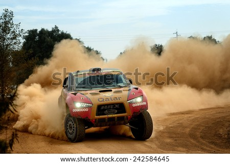 PORTALEGRE, PORTUGAL - NOV 1 : Qatari driver Nasser Al-Attiyah and his codriver Mathieu Baumel in a Ford HRX race in the 28th Baja Portalegre 500, on Nov 1, 2014 in Portalegre, Portugal. - stock photo