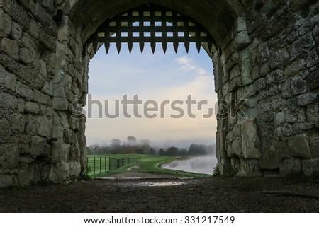 Portcullis in stone archway. Taken at Leeds castle, Kent. - stock photo
