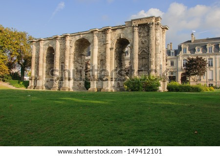 Porte Mars - An ancient Roman triumphal arch in Reims, France. It dates from the third century AD, and was the widest arch in the Roman world - stock photo
