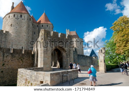 Porte Narbonnaise and turists at Carcassonne in France - stock photo