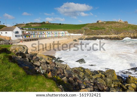 Porthgwidden beach St Ives Cornwall England with colourful beach huts, waves and blue sea and sky - stock photo