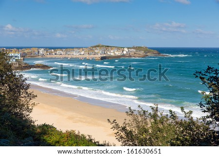 Porthminster beach St Ives Cornwall England with white waves and blue sea and sky on a beautiful summer day - stock photo